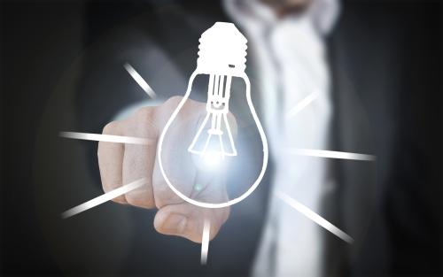 Canva - Hand Touching Lit Lightbulb